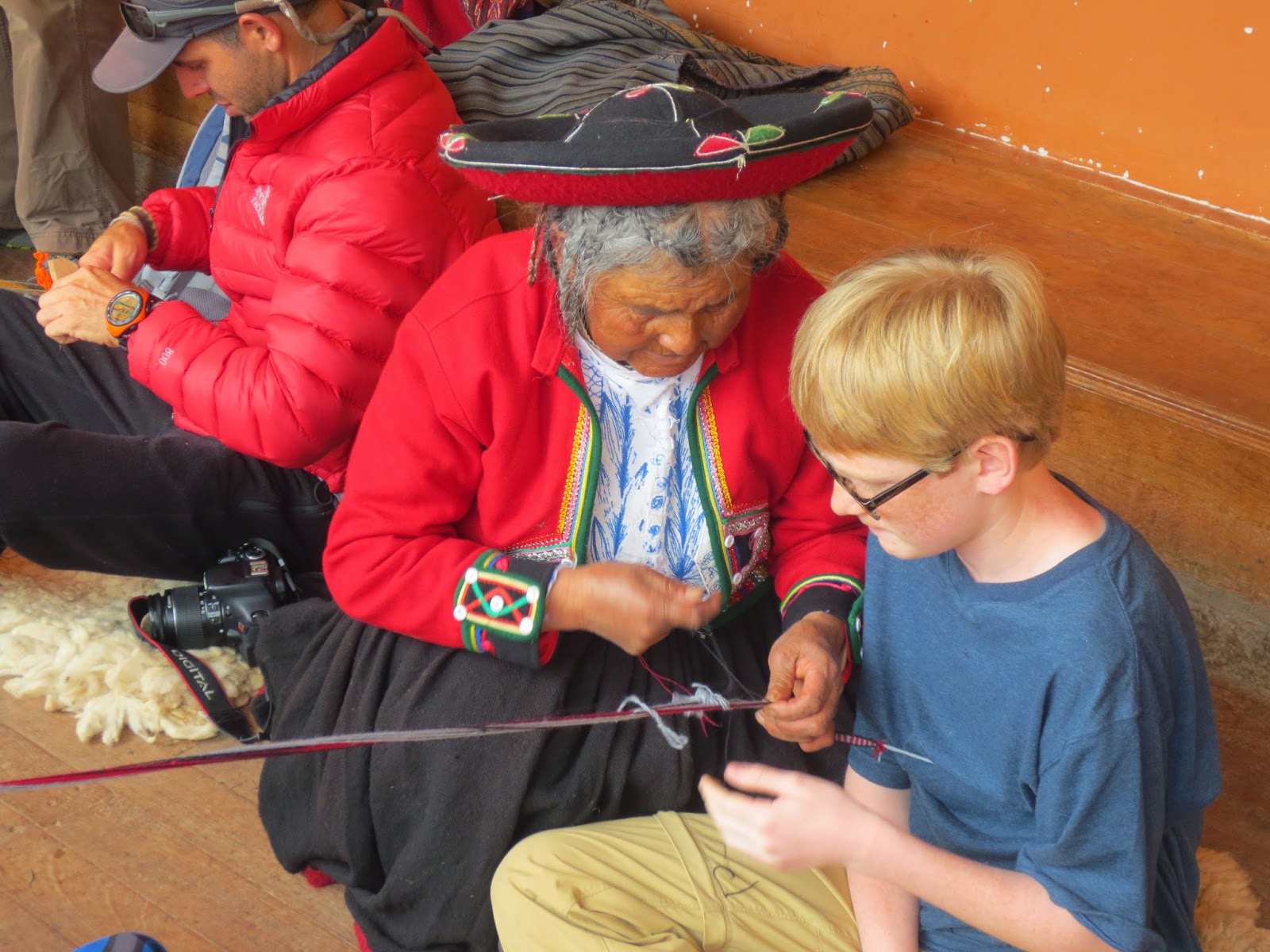 A middle school student learns traditional weaving techniques in Peru. Travel alerts issued after terrorists attack in European countries have convinced districts to send students elsewhere in the world.