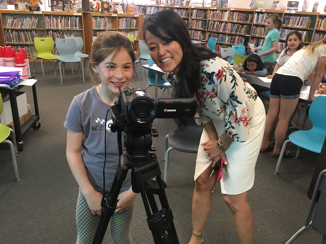 Superintendent Quynh Trueblood looks on as a student films footage for a video highlighting the Kohler school's Kindness Movement. Elementary school students documented 30,000 acts of kindness this year.