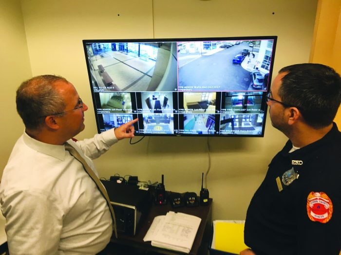 SAFETY SCAN—Yonkers security director Brian Schulder watches live feeds from surveillance cameras placed at some of the district's 39 schools.