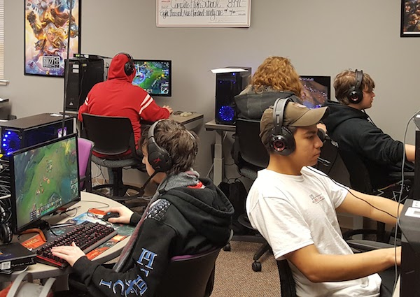HIGH SCORERS—Students play video games in an esports class at Complete High School Maize in Kansas. The course, which examines the social and cultural aspects of competitive gaming, helped students improve their grades and attendance.