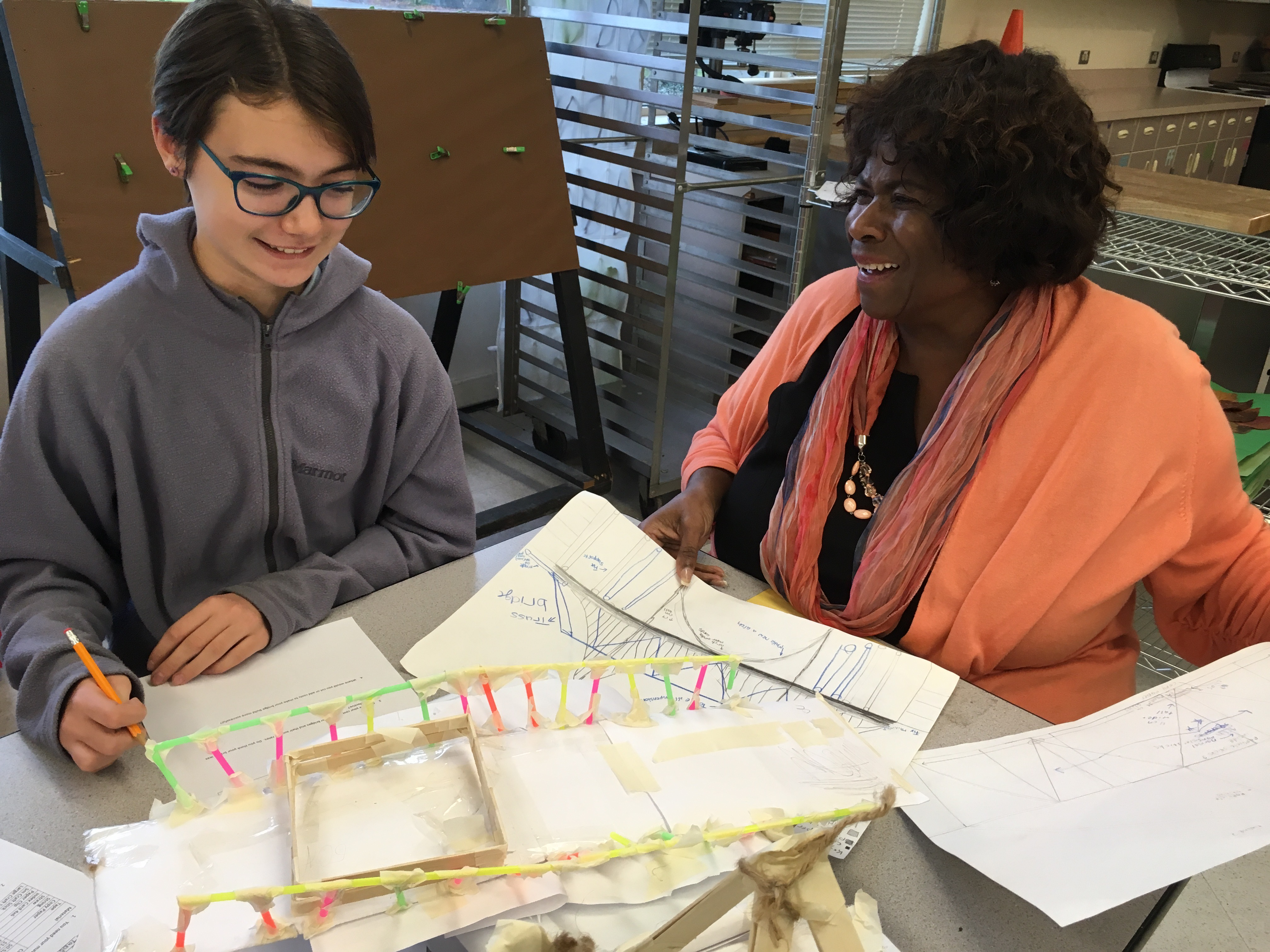 Superintendent Carla Santorno discusses a makerspace project with a student at Sherman Elementary School in Tacoma, Washington.