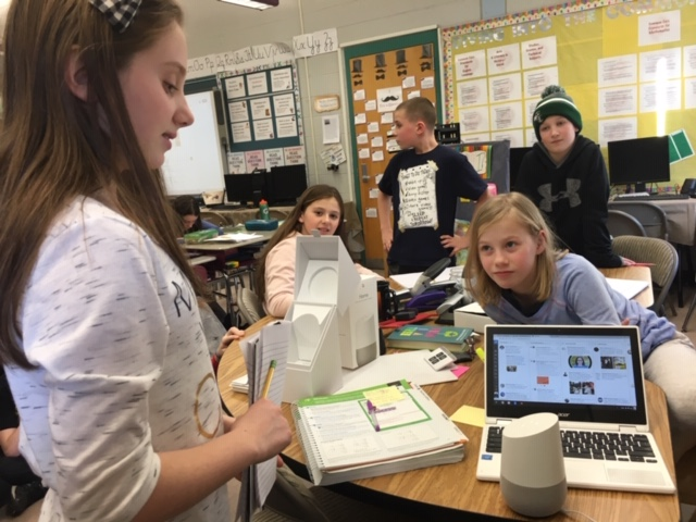 "VOICE-ACTIVATED TECHNOLOGY—In this fifth-grade classroom in Mansfield, Massachusetts, the teacher appoints a ""Googler of the Day"" to plug in the Home device when someone has a question, to ask that question, and then to unplug the device so it does not continue to record classroom activities."