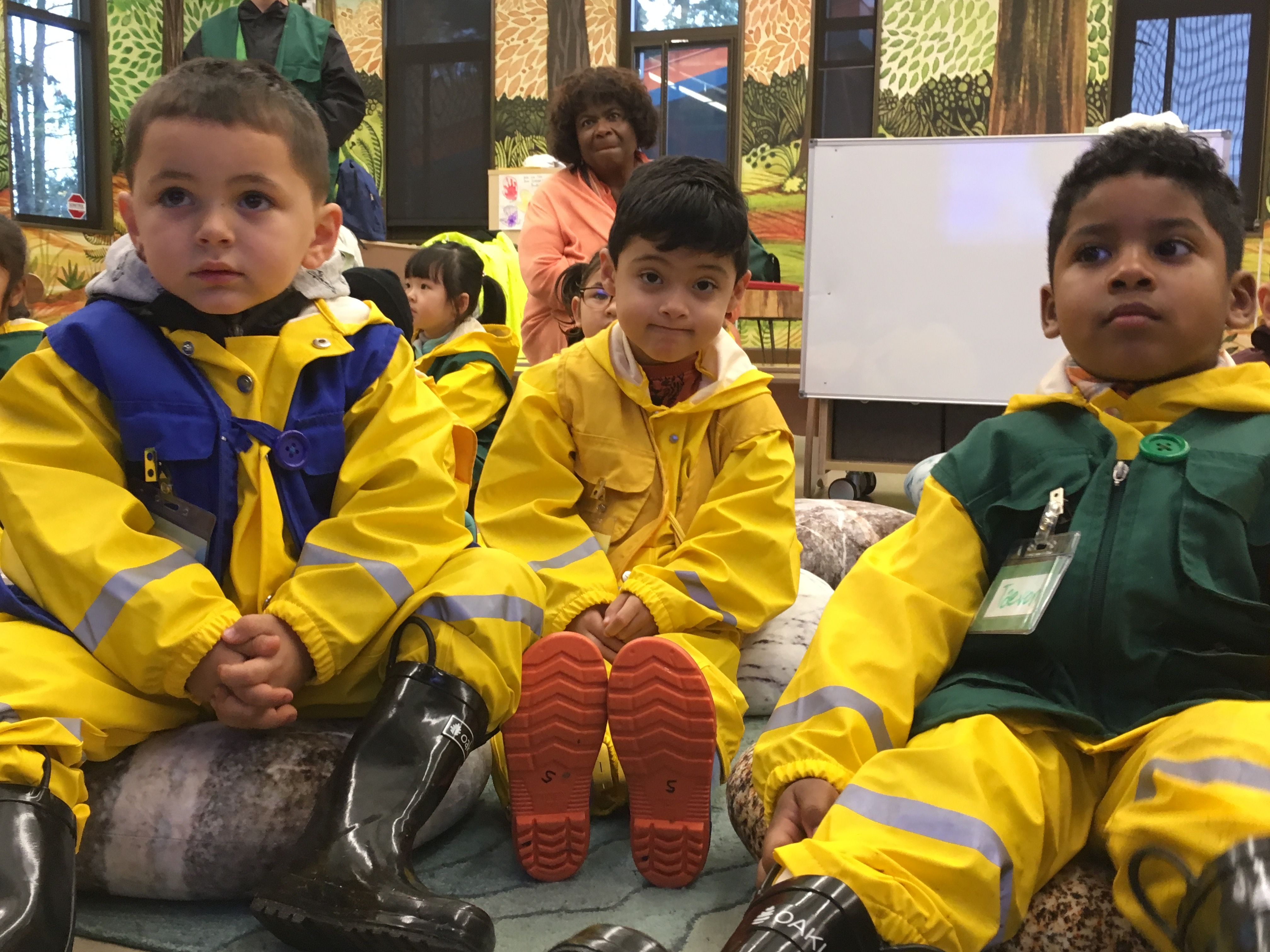 NATURAL CURIOSITY—Superintendent Carla Santorno looks on as visiting preschool students prepare for a nature hike in the rain at the Science and Math Institute, also known as SAMI, which may be the only high school in the nation that's located inside a zoo.
