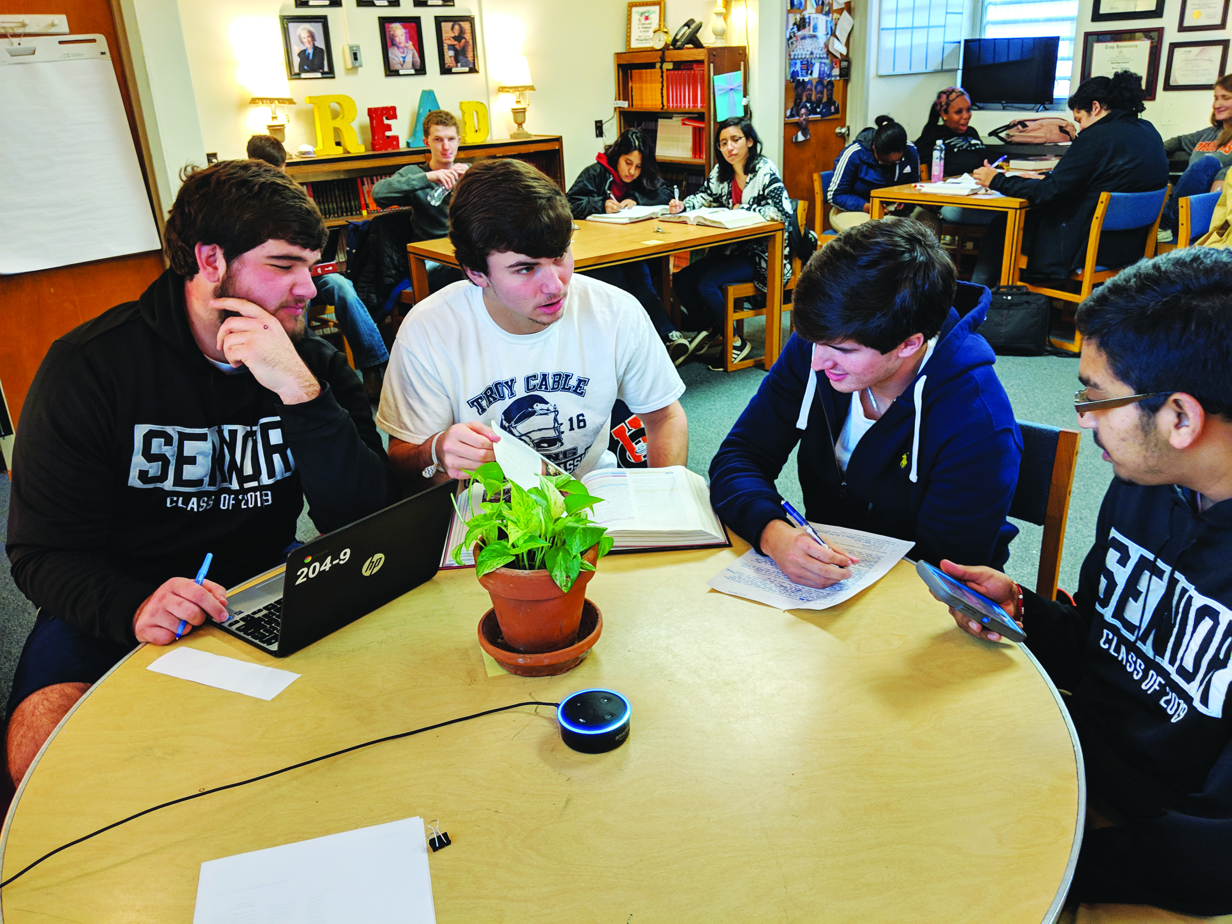 EDTECH EXPERIMENT—Students at Troy City Schools work with one of voice-activated devices teachers are piloting.