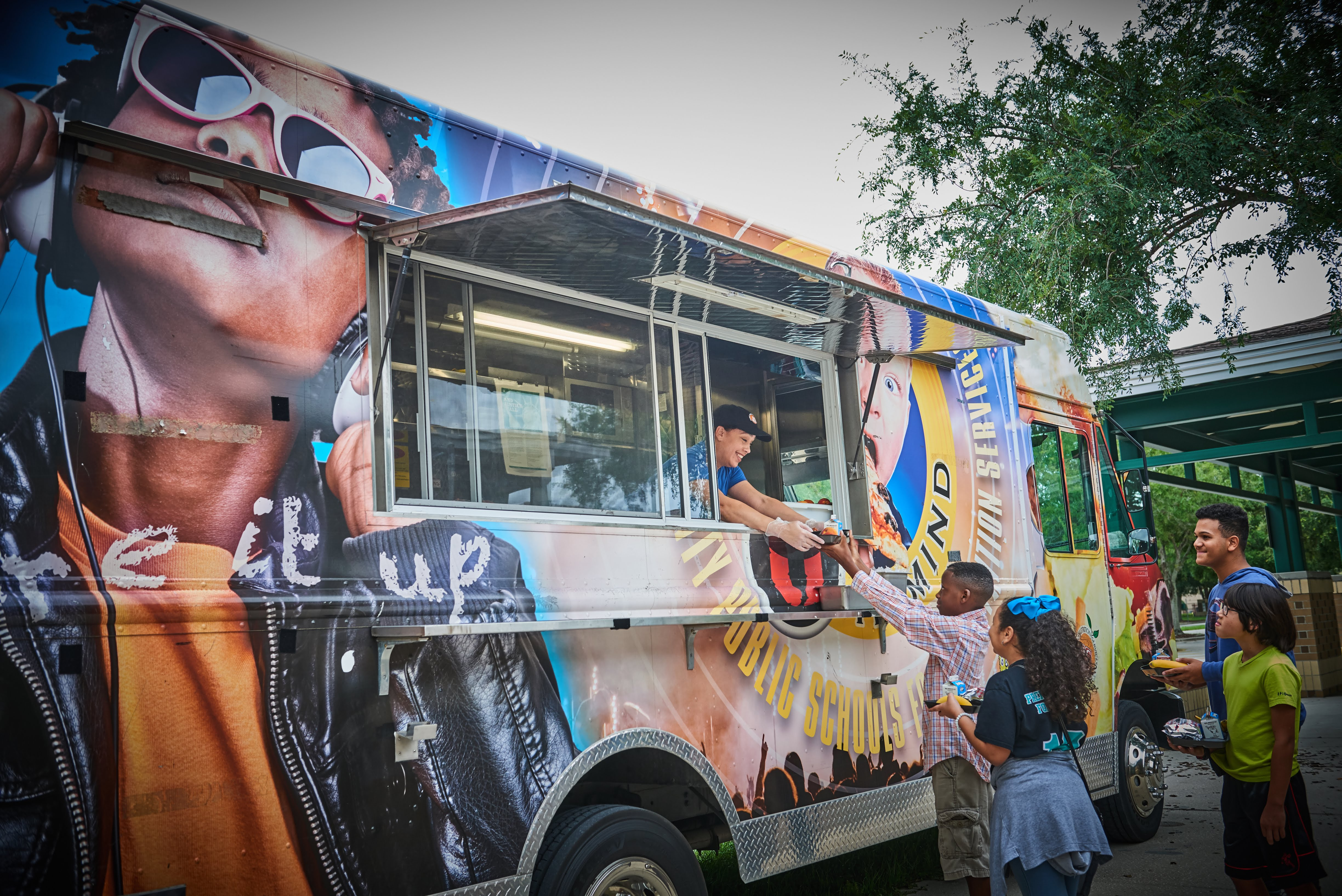 Students at Meadow Woods Middle School in Orlando buy school lunch from a food truck that visits regularly. The truck represents just one strategy Orange County Public Schools has employed to liven up lunch.