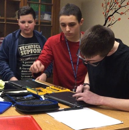 Once a month, Tech Team Junior members meet after school with IT staff to learn about hardware repairs, such as replacing keyboard keys and batteries.