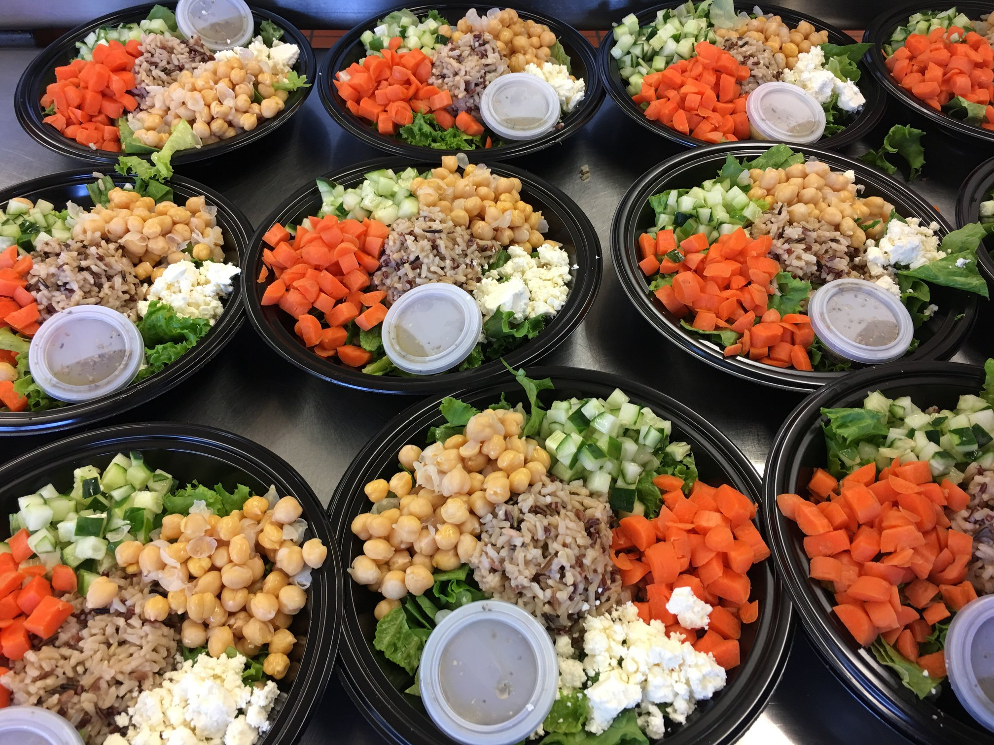 Loudoun County Public Schools serves students Greek veggie grain bowls for school lunch after eliminating all artificial sweeteners and dyes from their menus.