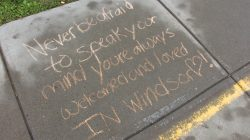 Students wrote positive messages outside of Windsor Central Middle School as part of an event against bullying.