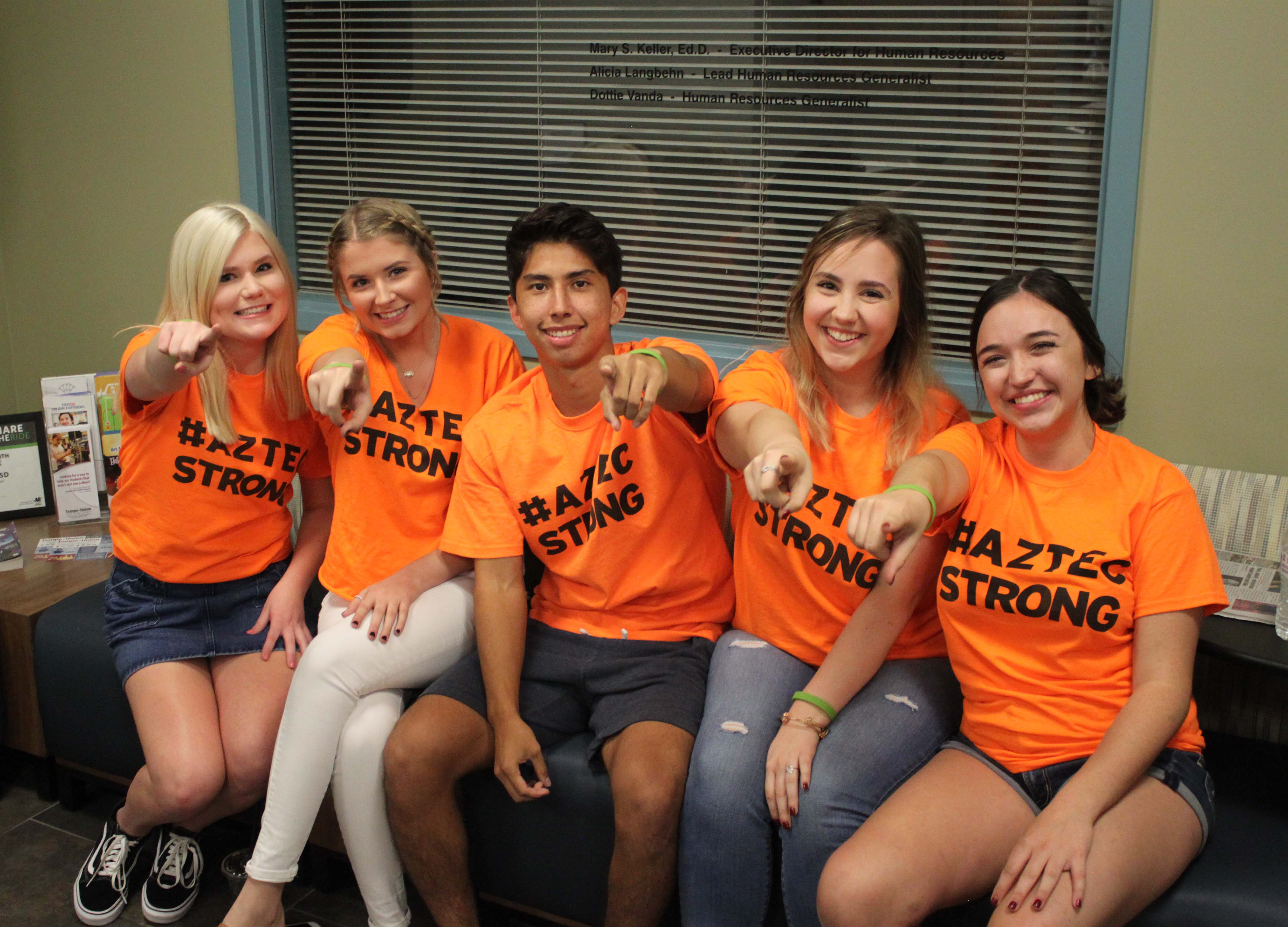 Student-led #AztecStrong support teams have formed at several schools in Arizona's Tempe Union High School District. The district also prints a suicide hotline number on ID badges.