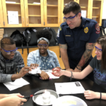 Local firefighters spark middle school STEM lessons