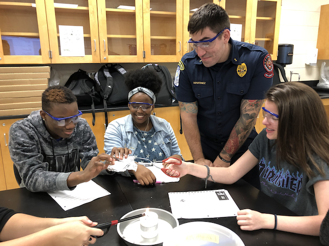 STEM students at East Cobb Middle School near Atlanta investigate fire dynamics, fire behavior and the fire triangle alongside fire service professionals from the Cobb County Fire Department.