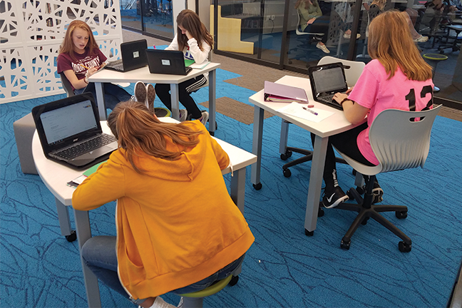 Students complete a class assignment in the School District of Sheboygan Falls in Wisconsin. The district has adopted Universal Design for Learning, which requires educators to create more flexible lesson plans that accommodate the learning style of each student.