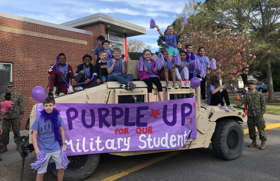 At Virginia Beach City Public Schools, leaders hold regular celebrations to recognize military-connected students. Here, students wear purple to honor the Month of the Military Child.