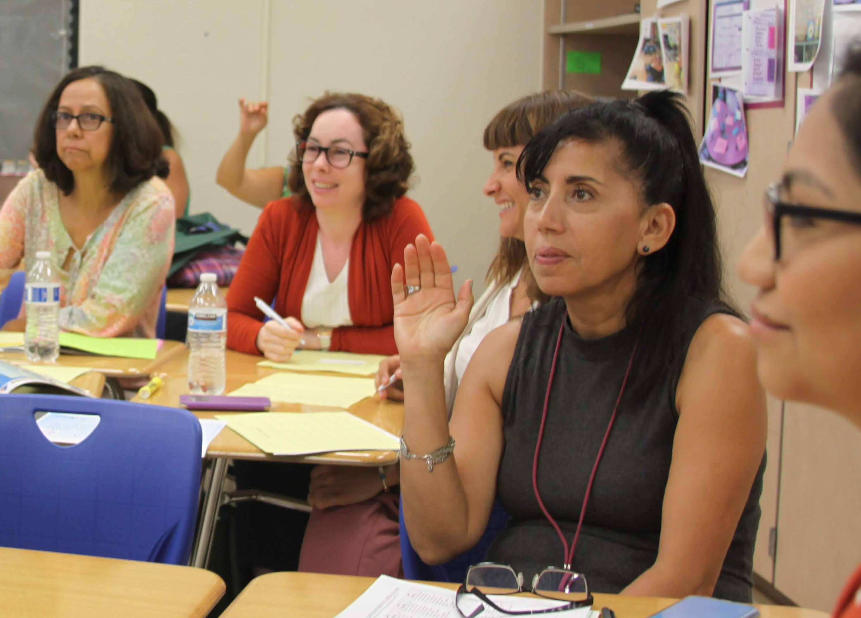Teachers in professional development programs at Florida's School District of Palm Beach County benefit from the school system's close working relationship the regions colleges and universities.