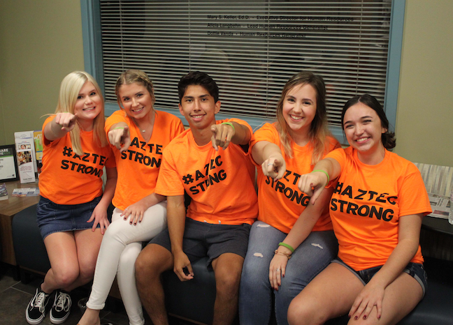 Student-led #AztecStrong student suicide awareness teams have formed at several schools in Arizona's Tempe Union High School District. The district also prints a suicide hotline number on ID badges.