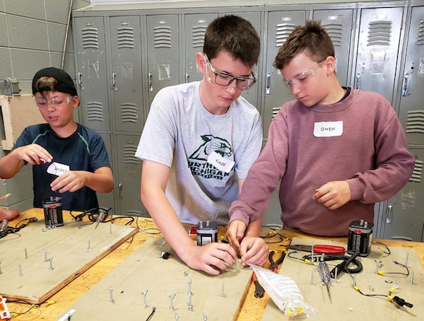 Students work on a project together in middle school CTE courses at the Careers in Technology summer camp held by the Delta-Schoolcraft Career Tech Center on Michigan's Upper Peninsula.