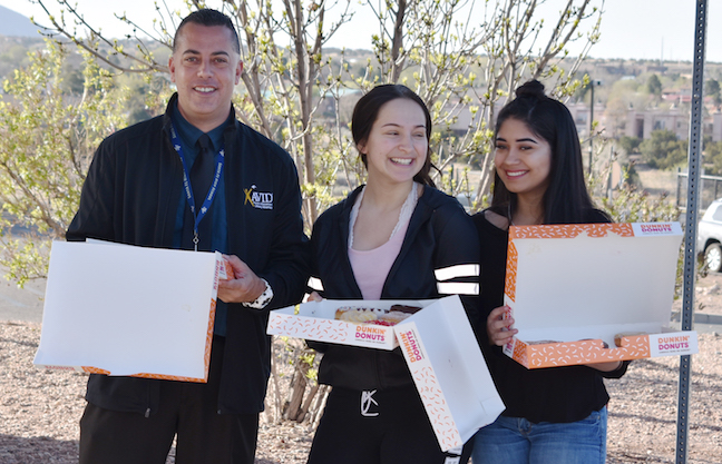 High school students who arrive before the first bell receive doughnuts as part of a comprehensive attendance initiative aimed at improving school attendance at Santa Fe Public Schools in New Mexico.