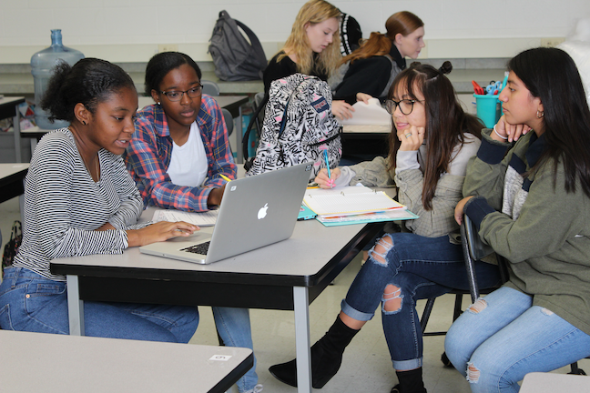 Students collaborate during a service project-planning session at Sussex Technical School District, which has been training teachers to recognize their own implicit bias to better support cultural diversity in the classroom.