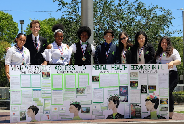 In Miami-Dade County Public Schools, the civic education curriculum teaches students how to promote a cause, such as mental health care for young people. As part of the civics curriculum, hey complete projects each year in the district's Project Citizen Fair.
