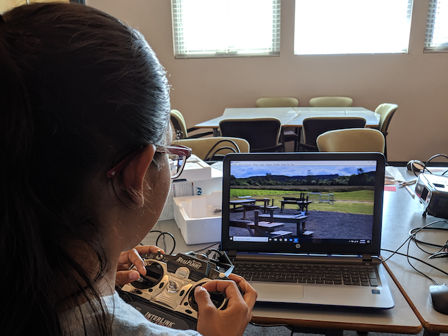 Students train on drone flight simulators as they work toward an FAA remote pilot certificate. They also code drones, learn airport operations, and meet with aeronautical engineering professionals.