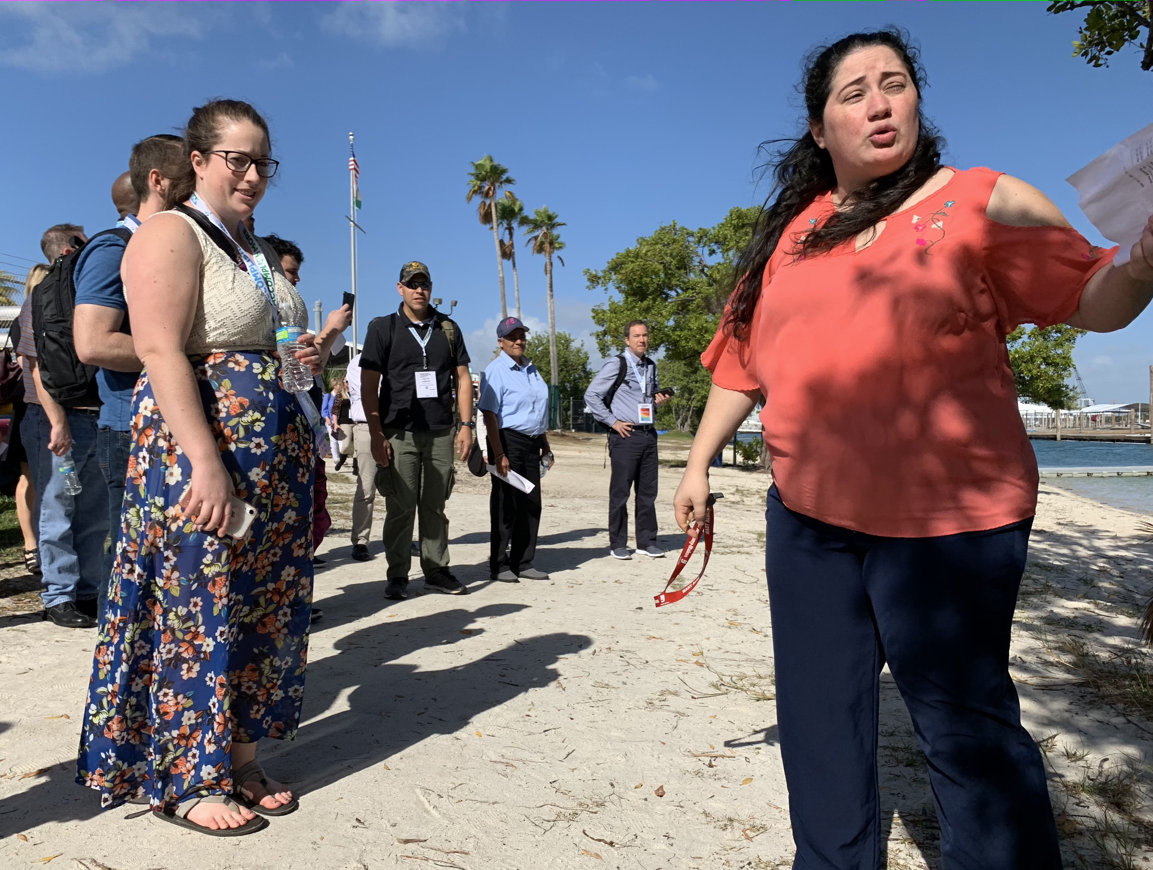 FETC attendees and MAST Academy's lead teacher walk the waterfront trail behind the school.