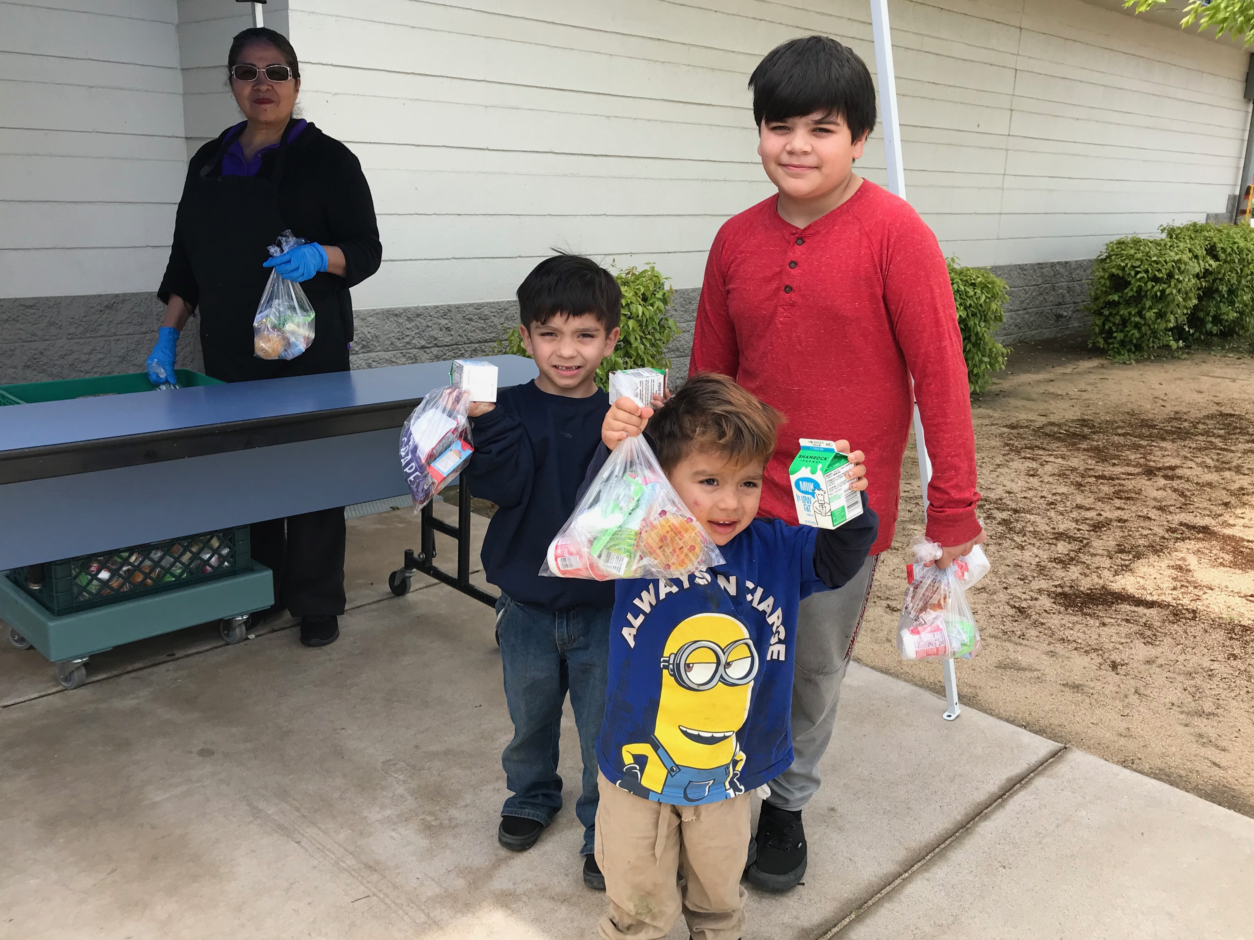 Each child gets two school lunches and breakfasts each time they visit one of the Alhambra Elementary School District's mobile food distribution spots in Phoenix.
