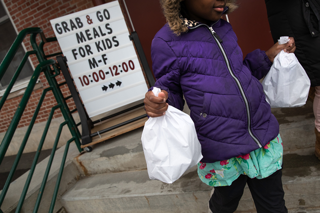 Stamford Public Schools in Connecticut also has a grab-and-go meals program, with each child being offered two bagged meals per day. Photo by John Moore/Getty Images