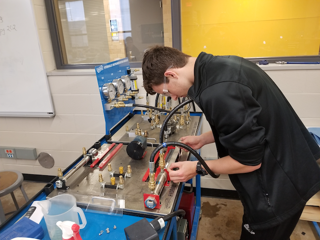 A high school student in Wichita Public School works on a project in the district's aviation manufacturing CTE pathway. Administrators in the Kansas school system worked with the city's airplane manufacturers to create the program.