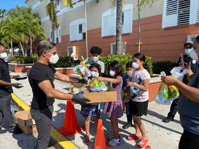 Miami-Dade County Public Schools Superintendent Alberto Carvalho, shown here handing out meals to students, has an aggressive plan to close achievement gaps caused by the coronavirus.