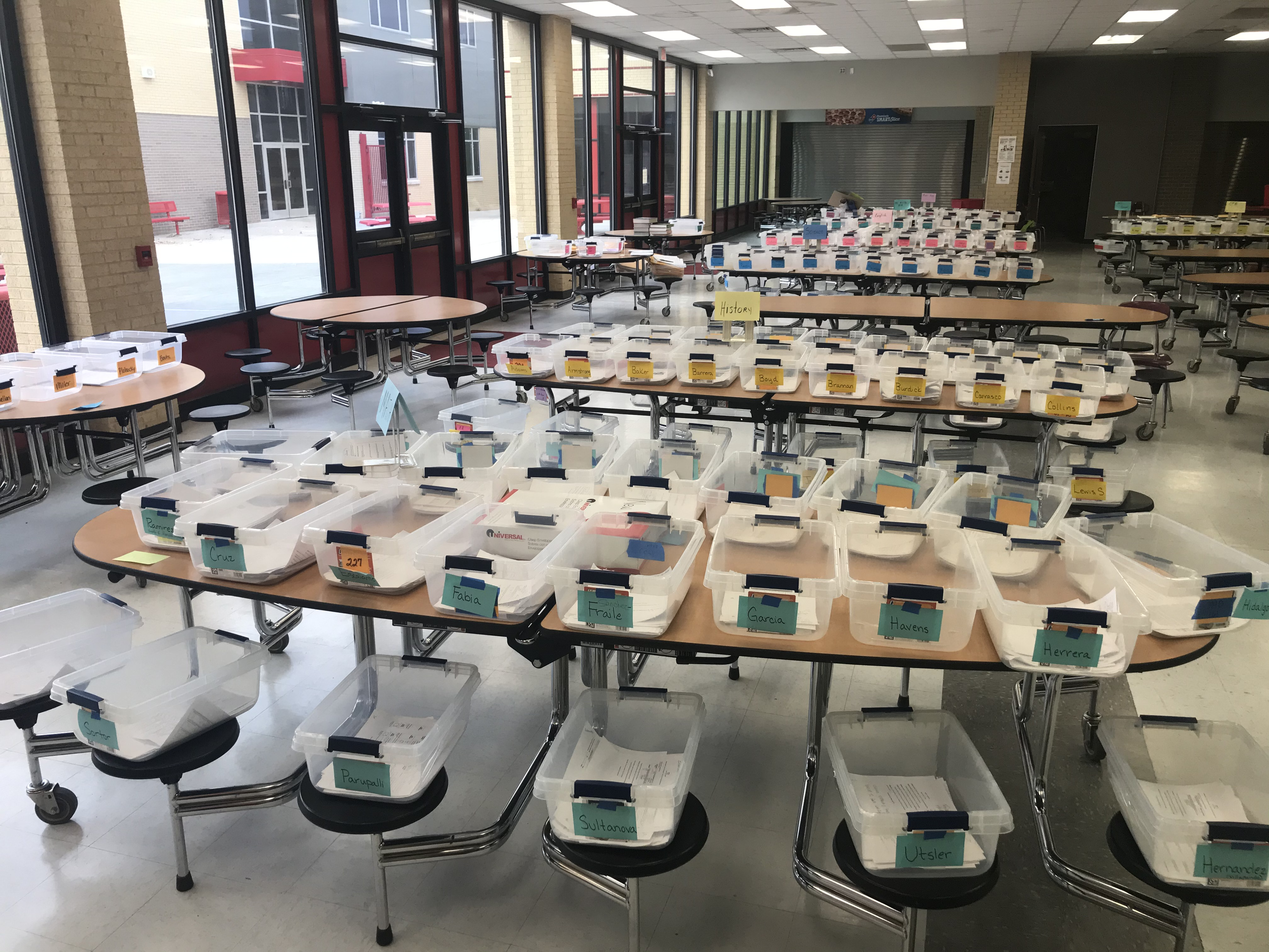 Rows and rows of assignment bins were broken out by subject and teacher for distribute work to students in Odessa High School's cafeteria this spring.