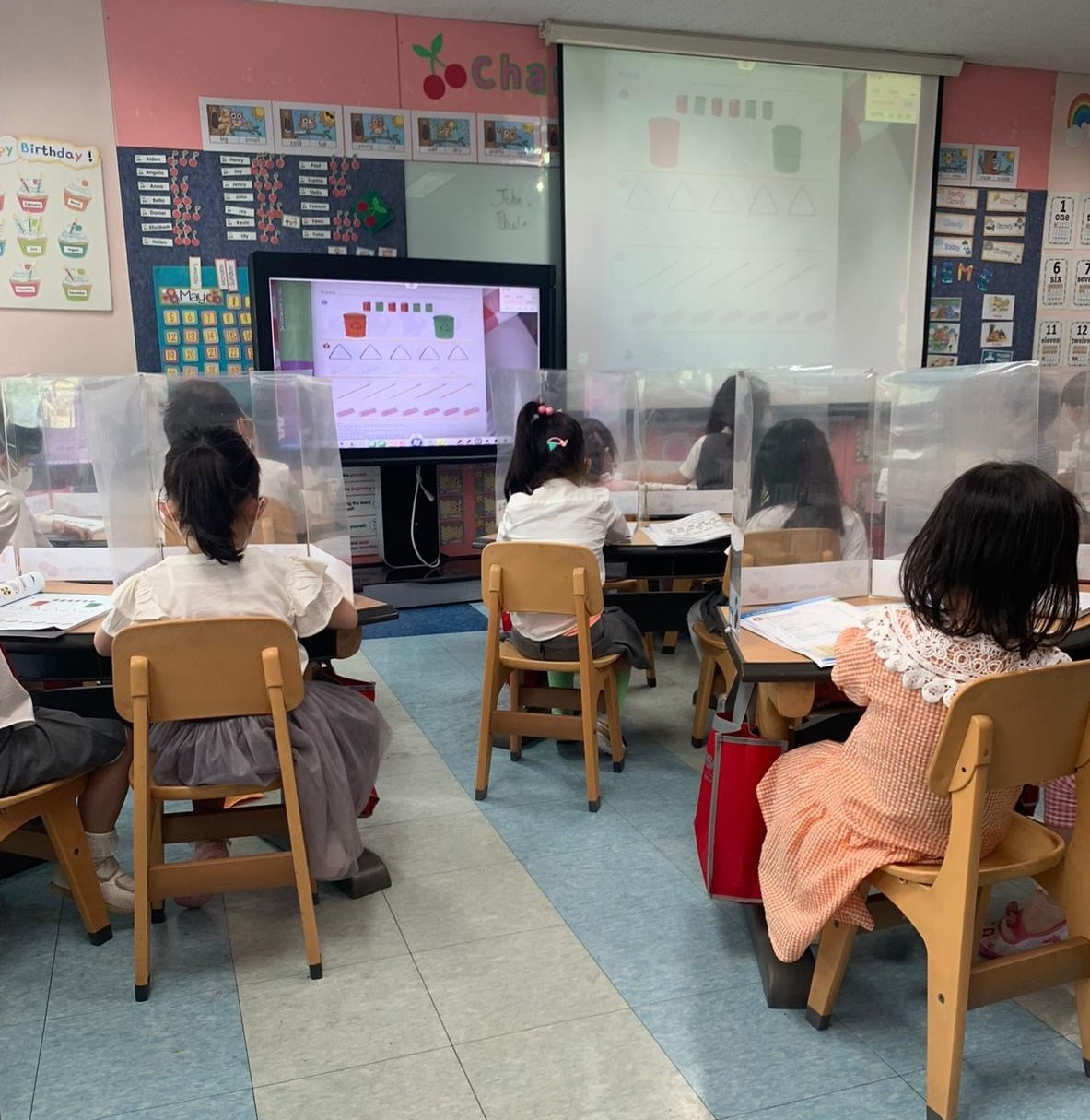 Teacher-created partitions are helping with social distancing in South Korean classrooms.
