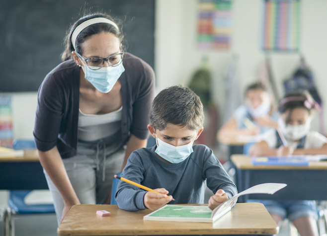 The CDC revised K12 safety guidelines—updated after President Donald Trump pressured school leaders to reopen to face-to-face learning—detail the importance of in-person instruction despite the risk of spreading COVID.(GettyImages/FatCamera)