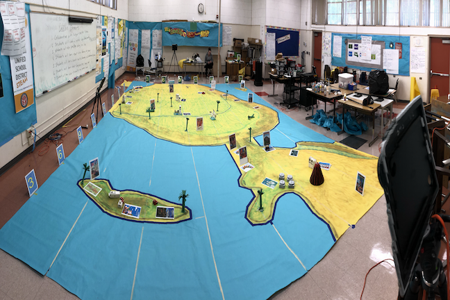 Remote students in a Compton USD middle school sent robots on educational mission on the room-size map of Latin America at Bunche Middle School.