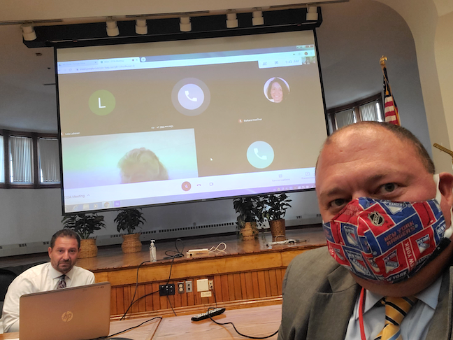 Meriden Public Schools Superintendent Mark Benigni (left) and Cheshire Public Schools Superintendent Jeffrey Solan temporarily swapped remote and in-person teachers to meet student demands in their neighboring Connecticut districts.