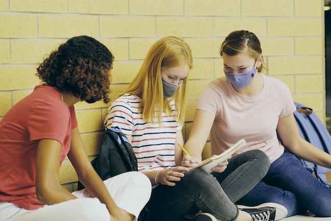 """56% of students describe themselves and their family as """"doing OK"""" during the pandemic while only 16% of students report they are struggling, a survey finds. (GettyImages/RichLegg)"""