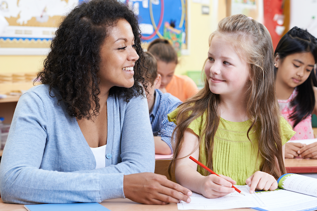Students of all racial and ethnic backgrounds view teachers of color favorably, and students of color perform better when they have teachers of color, teacher prep experts say, (AdobeStock/highwaystarz)