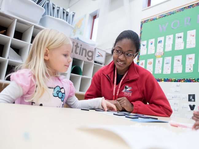A Minnesota Reading Corps tutor works with an elementary school student pre-COVID.