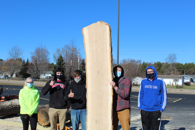 COVID hasn't prevented students at the School District of Waupaca in southern Wisconsin from learning to use a sawmill.