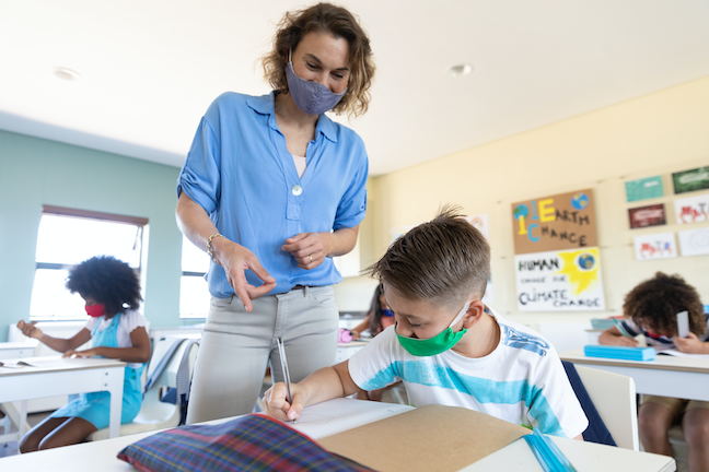 """Many teachers aer """"going above and beyond"""" to educate students during the pandemic say administrators interviewed by researchers for a report on teaching shortages. (AdobeStock/wavebreak3)"""