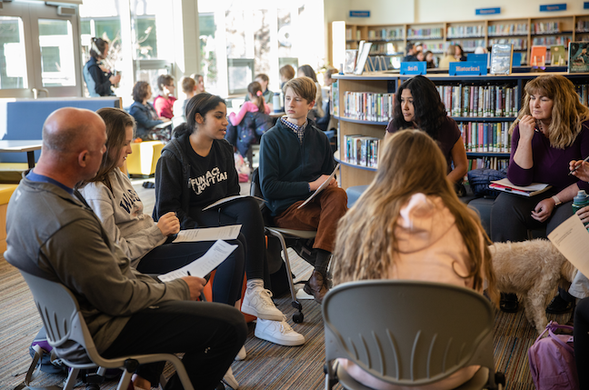 Students from Newburyport High School in Massachusetts lead dialogues with students and teachers from nearby Nock Middle School in this pre-COVID photo.