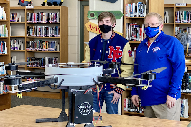A student and District Administrator Scott Foster examine a drone that will bring internet access to students in the rural Wisconsin district.