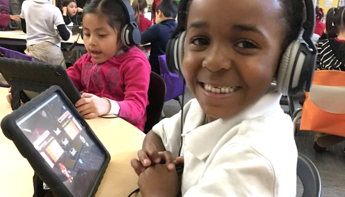 As part of the tutoring process, students complete game-based literacy lessons on Innovations for Learning devices that run its software and curriculum.