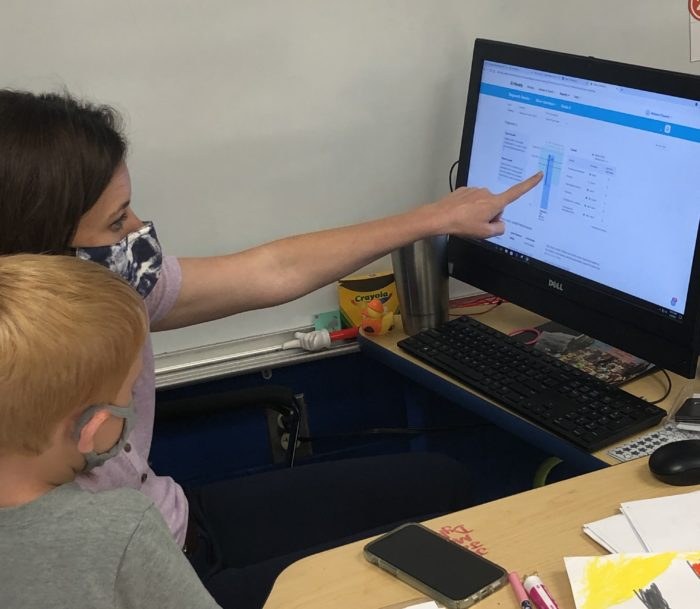 A teacher shows a student his data dashboard in Mississippi's Pass Christian School District.