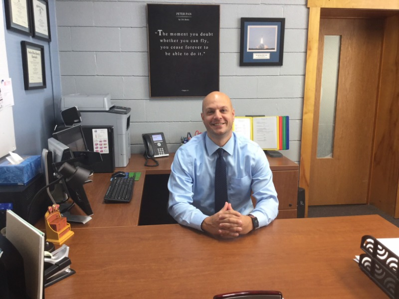 Superintendent David Deets sitting at his desk in his office.