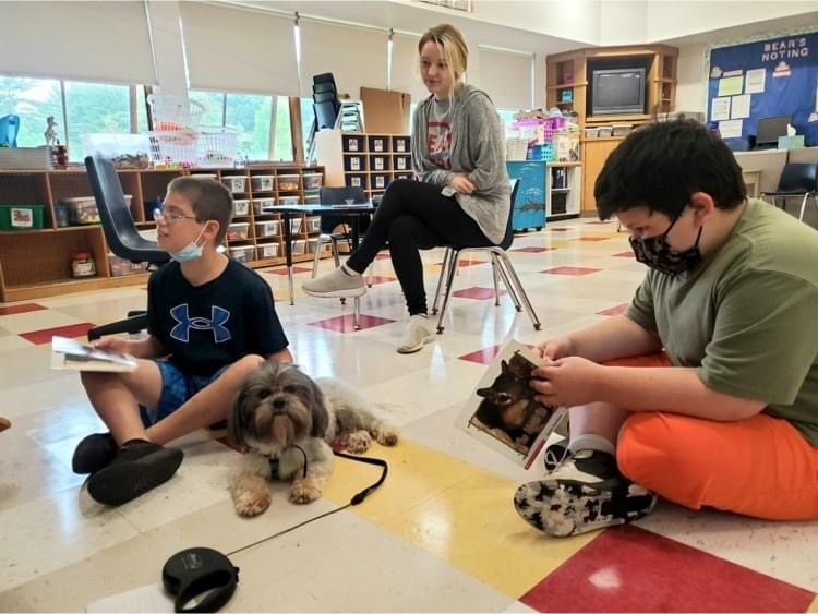 Students read to Mojo the therapy dog during accelerated academies offered this summer by the Spencer-East Brookfield Regional School District