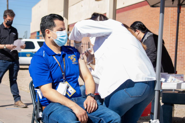 A school staff member in the Phoenix Union High School District in Arizona gets vaccinated earlier this year.