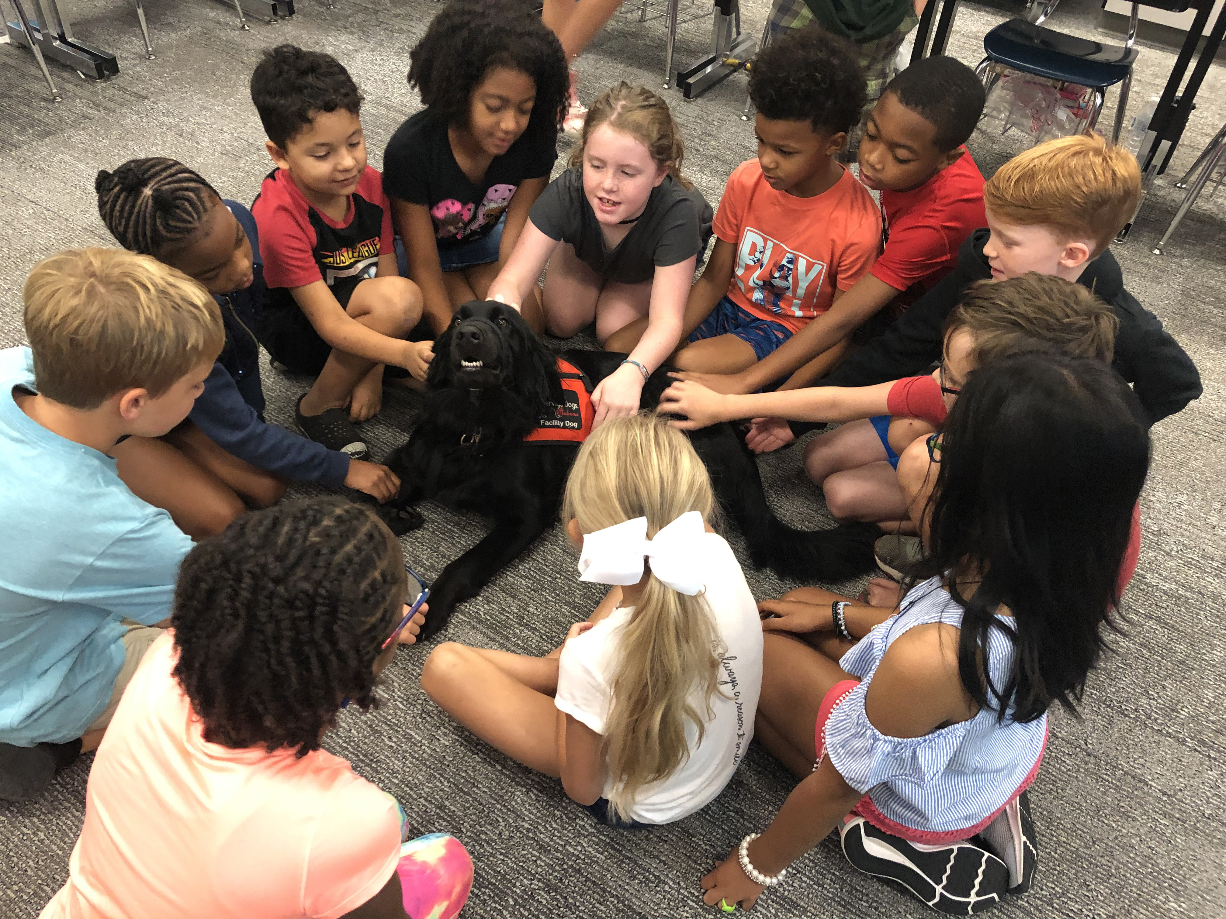 Students visit with Hall-Kent Elementary School's dog, Maize, in Alabama. (Photo provided by U.S. Department of Education)